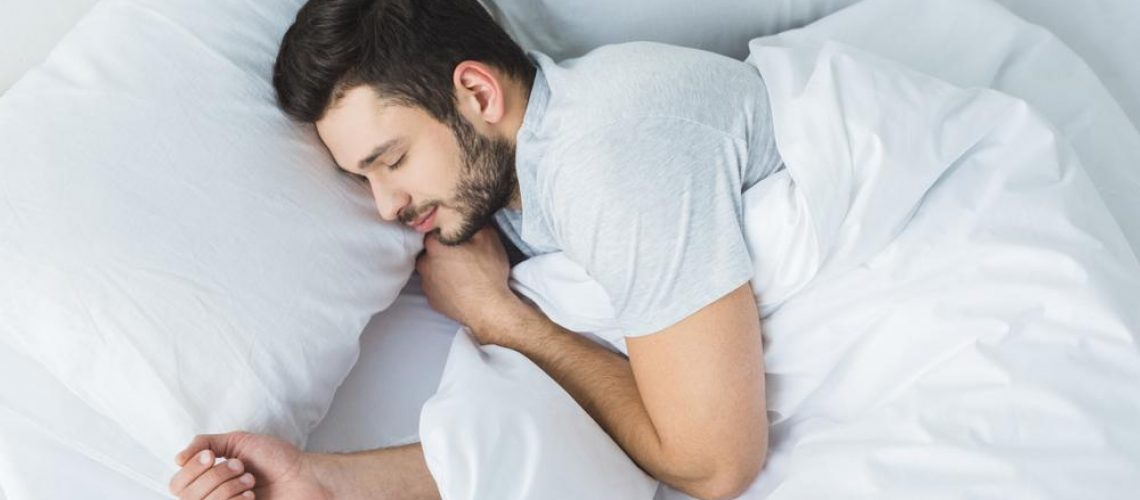 Man sleeping with air conditioning
