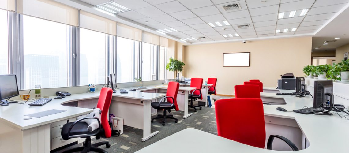 Open modern office with red chairs